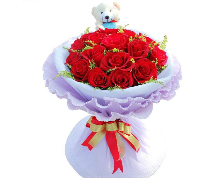 19枝红玫瑰,搭配黄莺 ,另加可爱小熊一只.